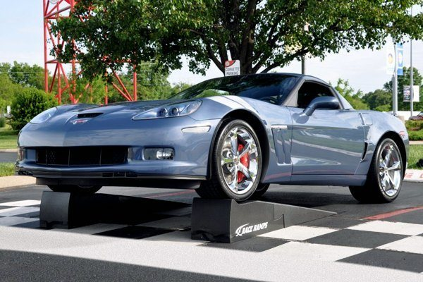 Chevy Corvette on a car ramp.
